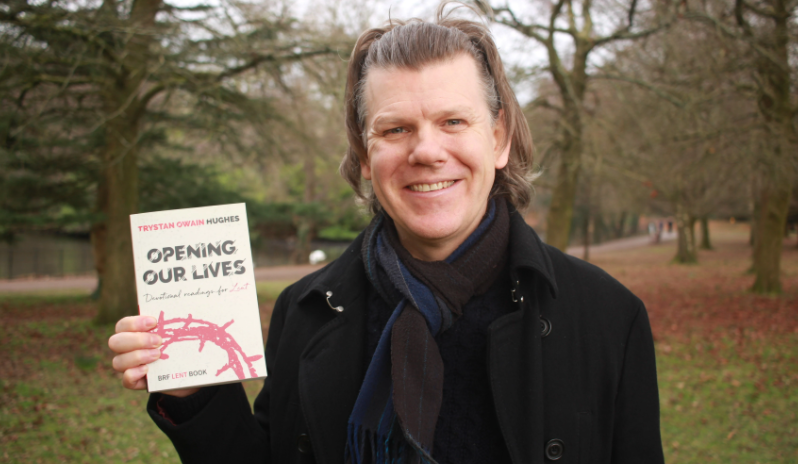 The Revd Dr Trystan Owain Hughes holding up his Lent book, Opening our Lives