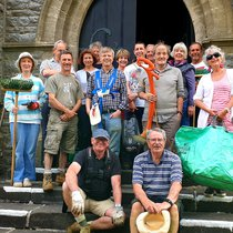 People volunteering to clear a churchyard