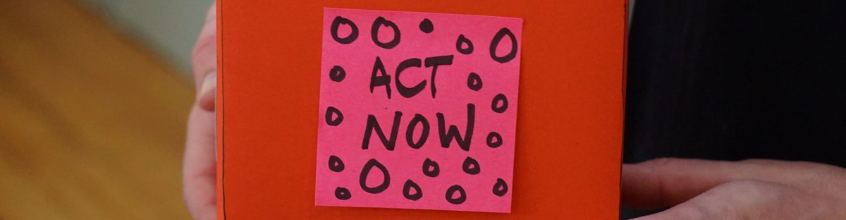 Box with a sticky note saying act now