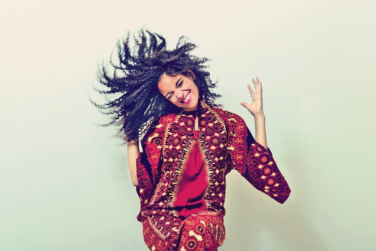 Singer songwriter Kizzy Crawford dancing and smiling to the camera
