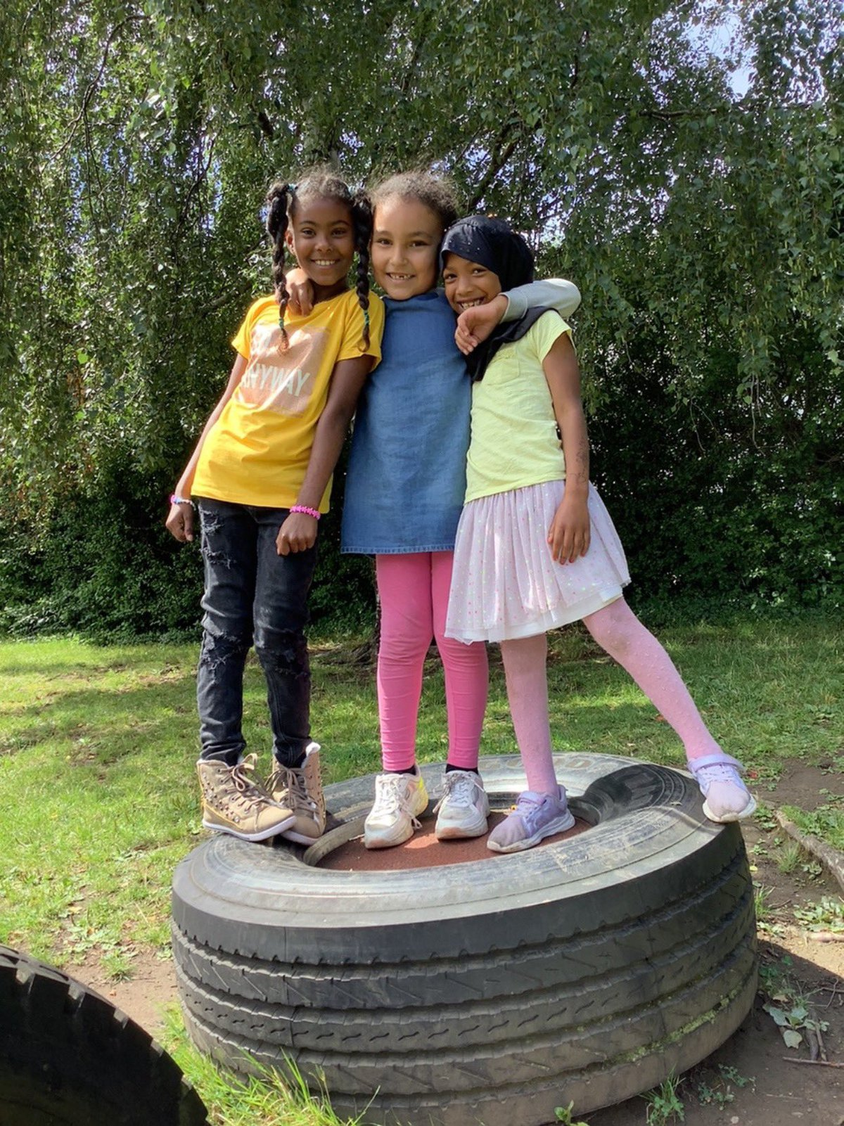 Pupils at St Mary's primary school standing on a tyre