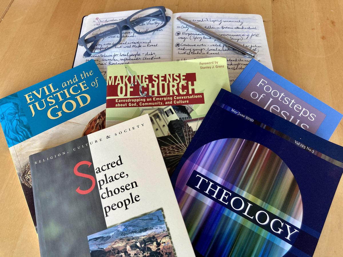 Selection of theology text books and a notepad