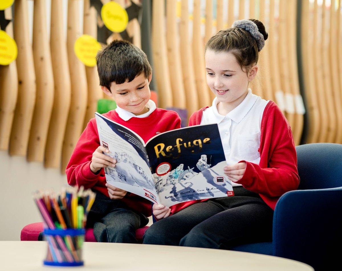 Children reading the book Refuge