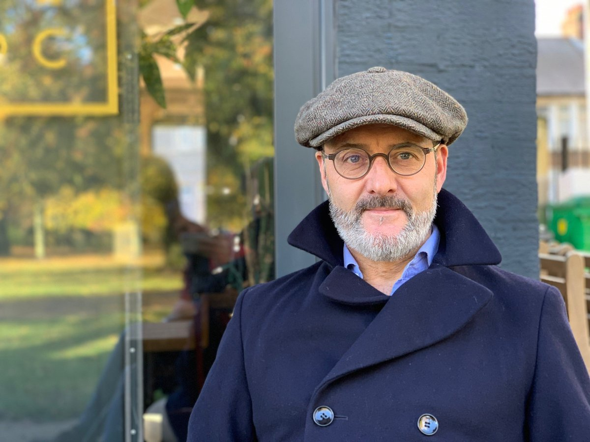 Revd Gareth Rayner-Williams in a flat cap and jacket