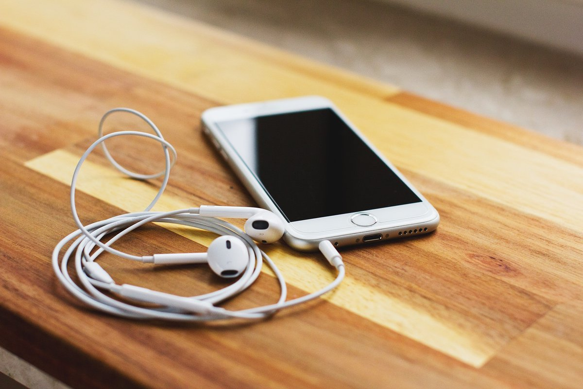 Phone and headphones for listening to a podcast